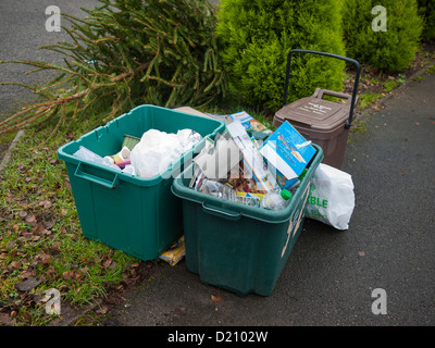 Recyling boxes outside homes waiting for collection. - Stock Photo