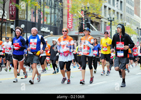 USA Illinois Chicago. The 2012 and 35th Chicago Marathon runners down State Street about two miles into the course. - Stock Photo