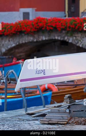 Boats in Cassone harbour in the evening light, Lake Garda, Malcesine, Veneto, Italy - Stock Photo