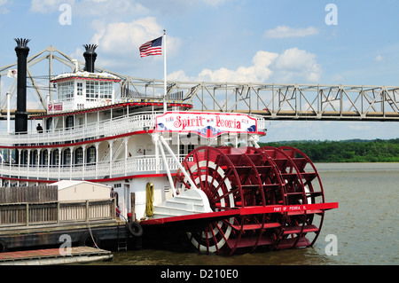 USA Illinois Peoria Spirit of Peoria riverboat anchored riverfront area built 1988 Murray Baker Bridge and Interstate - Stock Photo