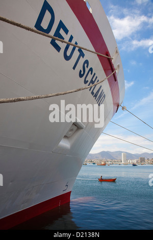 Cruise ship MS Deutschland, Reederei Peter Deilmann and fishing dinghy, Coquimbo, Chile, South America - Stock Photo