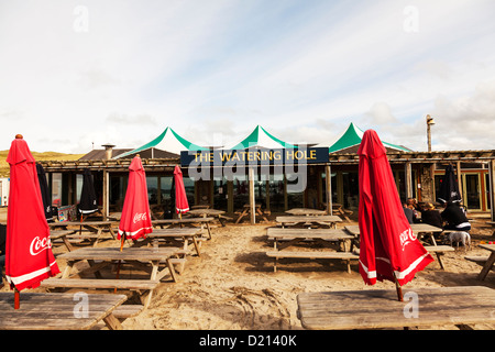 Perranporth Perrenporth, The Watering Hole Bar, Cornwall, UK, England outside tables and umbrellas exterior of building - Stock Photo