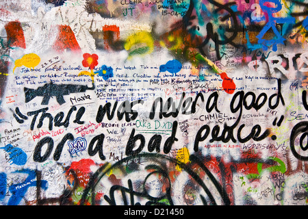 Urban graffiti street art slogan words on John Lennon Wall Prague Czech Republic Europe - Stock Photo