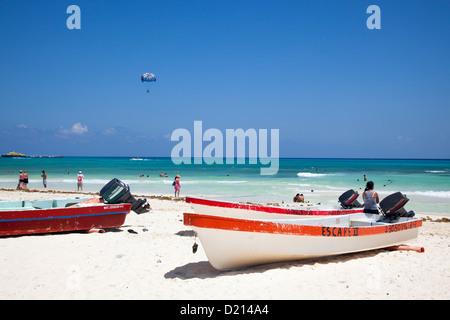 Fishing boats on the beach, Playa del Carmen, Riviera Maya, Quintana Roo, Mexico - Stock Photo