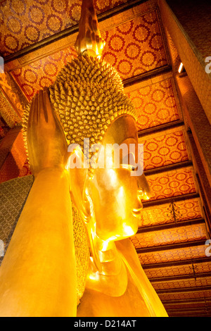 Giant reclining gold Buddha at Wat Po Buddhist Temple, oldest and largest temple complex in Bangkok Thailand Asia - Stock Photo