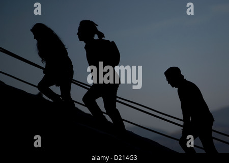 People climb the stairs of the Pyramid of the Sun in the archaeological site of Teotihuacan, Mexico - Stock Photo