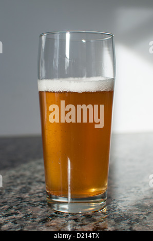 Craft beer glass with blonde beer - Stock Photo