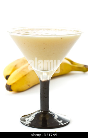 Banana shake with bananas on white background - Stock Photo