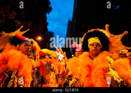 Brazilian men, dressed in fancy costumes, perform during the carnival street party in Rio de Janeiro, Brazil. - Stock Photo