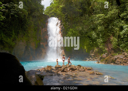 People in front of waterfall Rio Celeste, Tenorio National Park, Costa Rica, Central America, America - Stock Photo