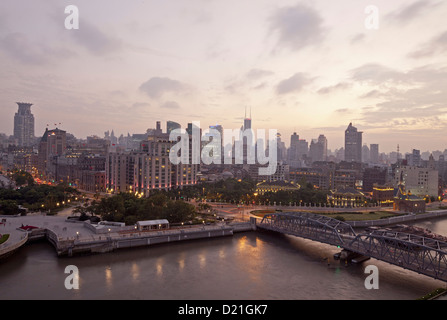 View of Waibaidu Bridge over the Huagpu River and houses of Bund in the evening, Shanghai, China, Asia - Stock Photo