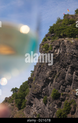 The Loreley Rock and a glass of wine seen from Rhine river cruise ship MS Bellevue, Sankt Goarshausen, Rhineland - Stock Photo