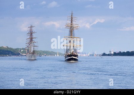 Windjammer tall sailing ships Dar Mlodziezy and Krusenstern on Elbe river as part of Hamburg harbour birthday celebrations, - Stock Photo