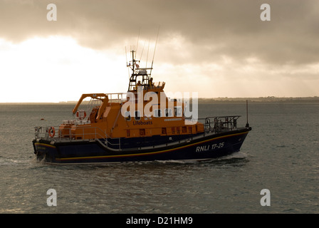 An RNLI lifeboat leaving Yarmouth on the Isle of Wight - Stock Photo