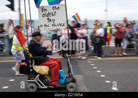A man in a disability scooter taking part in Brighton Pride. - Stock Photo