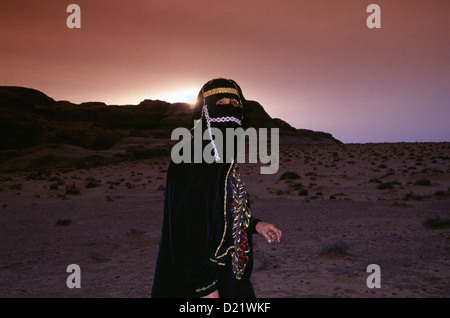 Bedouin woman member of the Zawaideh tribe, native to the deserts of southern Jordan and western Saudi Arabia wearing - Stock Photo