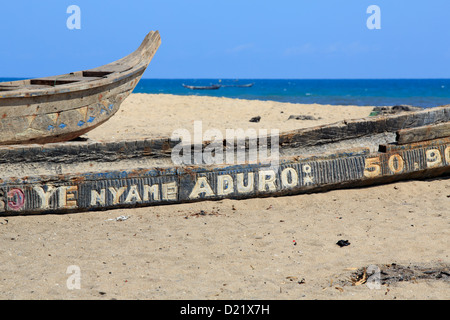 Old fishing boats on the beach in Jamestown, Accra, Ghana - Stock Photo