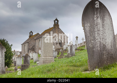 Gravestones and chapel in the background in Barnoon cemetary, St Ives, Cornwall. - Stock Photo