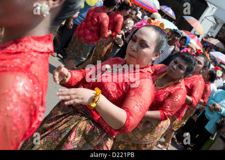 Women participants dance at a Harvest Festival parade in the village of Tumpang, Java, Indonesia - Stock Photo