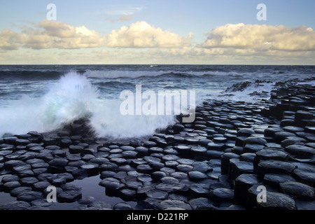 Waves splashing on the great hexagon stones of the Giant's Causeway from the Antrim coast, Northern Ireland. - Stock Photo