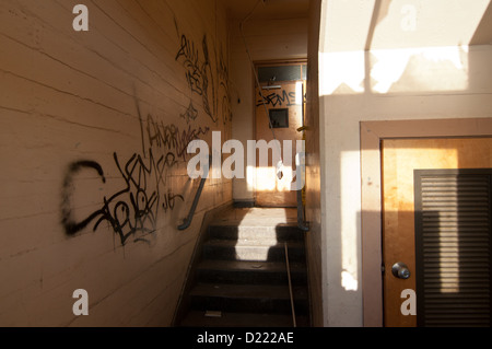 Doorway and graffiti at the historic Mare Island Naval Shipyard near Vallejo, California. - Stock Photo