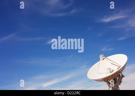 A radio telescope dish in the Very Large Array (VLA), New Mexico.  Copy space. - Stock Photo