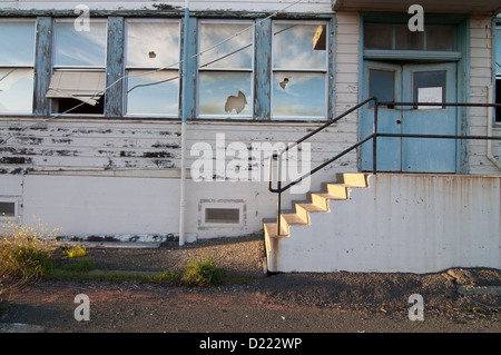 Broken windows and doorway at the historic Mare Island Naval Shipyard near Vallejo, California. - Stock Photo