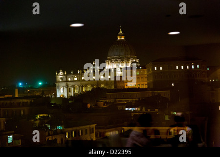 Saint Peter's cathedral dome view in the distance from a window Rome Italy - Stock Photo