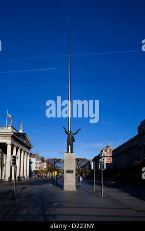 Jim Larkin Statue and Spire of Dublin, 'Monument of Light', Near GPO, O'Connell Street in Dublin, Ireland. - Stock Photo