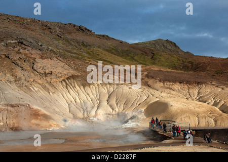 Tourist at Krysuvik-Seltun geothermal area in Iceland. - Stock Photo