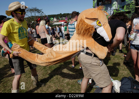 a festivalgoer in animal suit being carried at BESTIVAL FESTIVAL, ISLE OF WHITE, SEPTEMBER 2012 - Stock Photo