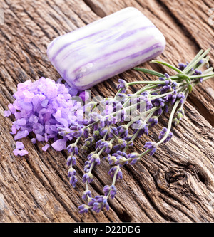 Bunch of lavender, soap and sea salt on a wooden table. - Stock Photo