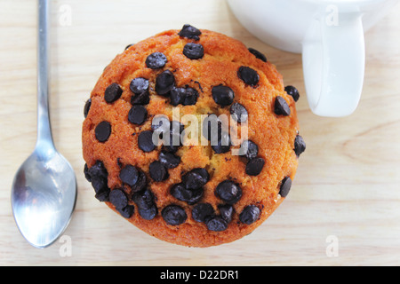 Chocolate chip muffin in paper cups wooden - Stock Photo