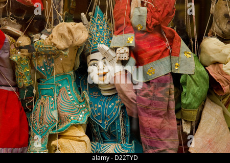 Marionettes hanging in shop window on island of Burano in Venice Lagoon. - Stock Photo
