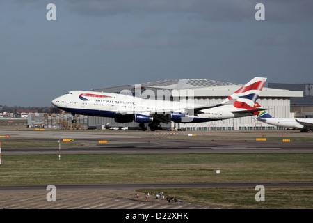 British Airways Boeing 747 Landing at London Heathrow Airport - Stock Photo