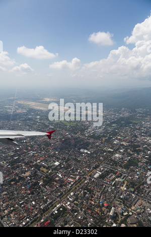 flying over Chiang Mai city in north Thailand - Stock Photo