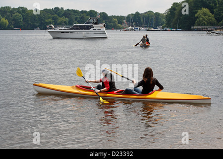 Berlin, Germany, two girls paddling on the river Havel - Stock Photo