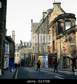 People walking in the street and a view of historical buildings on Candlemaker Row in Edinburgh Scotland UK  KATHY - Stock Photo