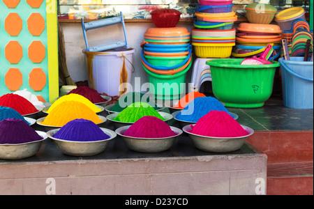 Coloured Indian powder in metal bowls used for making rangoli designs at festivals. Andhra Pradesh, India - Stock Photo