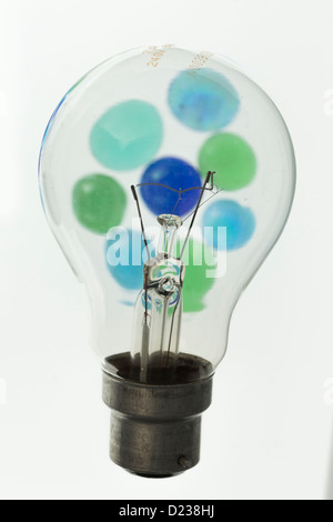 Colour and lightbulb on white background - Stock Photo