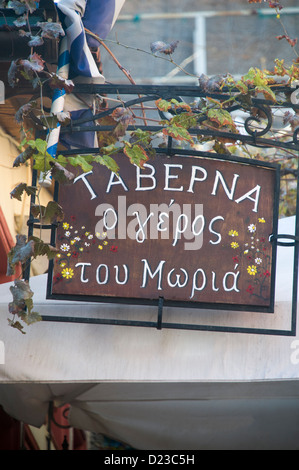 A Taverna sign in Greek in the Narrow Mnisikleous street, Plaka, Athens, Greece - Stock Photo