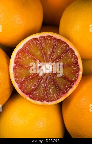 Citrus x sinenesis. Blood Oranges in a fruit bowl. - Stock Photo