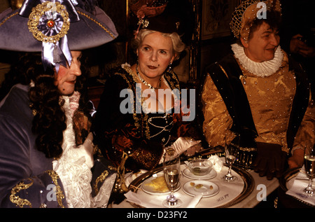 Revelers in costume siting in Florian coffee shop in Piazza San Marco during Venice Carnival festival Italy - Stock Photo