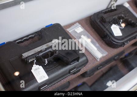 Handguns on display at a gun store.  - Stock Photo