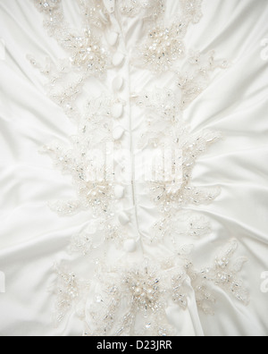 Detail of buttons and beading on a white wedding dress - Stock Photo