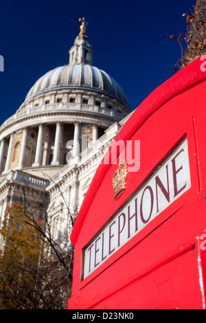 St Paul's Cathedral with traditional red telephone box in foreground City of London England UK - Stock Photo