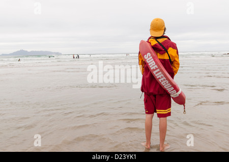 One young lifeguard watching people in water. - Stock Photo