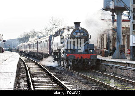 Steam locomotive pulling a passenger train on the East Lancs Railway at Ramsbottom - Stock Photo