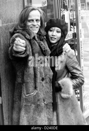 (dpa files) - German actor Klaus Kinski puts his arm around his third wife Vietnamese Genevieve Minhoi during walk in West Berlin 19 November 1971. enfant terrible of film industry Kinski s films include Doctor Zhivago (1965) For Few Dollars More (1966) as well as Aguirre der Zorn Gottes (Aguirre: Wrath of God) Nosferatu: Phantom der Nacht Nosferatu Vampire. Kinski was born on 18 October 1926 in Danzig Germany (now Gdansk Poland) under name of Nikolaus Guenther Nakszynski died on 23 November 1991 in Lagunitas California of heart attack.