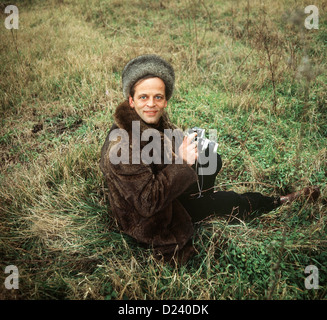 (dpa files) - German actor Klaus Kinski sits in the grass, holding a camera, 2 September 1969. An 'enfant terrible' of the film industry, his films include 'Aguirre, der Zorn Gottes' ('Aguirre: The Wrath of God') and 'Nosferatu: Phantom der Nacht' ('Nosferatu the Vampire'). Kinski was born on 18 October 1926 in Zoppot/Danzig, Germany (now Sopot/Gdansk, Poland) under the name of Nikolaus Guenther Nakszynski and died on 23 November 1991 in Lagunitas, California, of a heart attack.